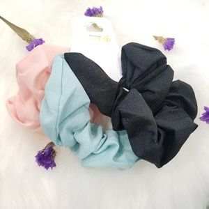 Pink, blue and black scrunchies